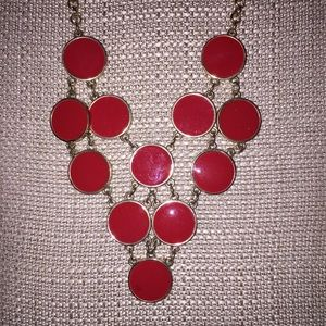 Orange/red token necklace w/gold tone  chain